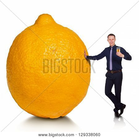 If fate has presented you a lemon, make lemonade. Cheerful young man made from lemon delicious lemonade. Conceptual allegory.