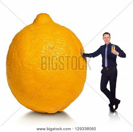 If fate has presented you a lemon, make lemonade. Cheerful young man made from lemon delicious lemonade. Conceptual allegory.