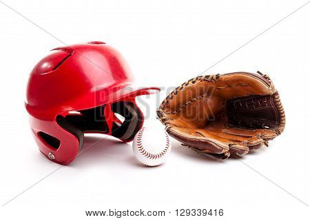 Baseball equipment consisting of red helmet leather glove and baseball. Isolated on white background.