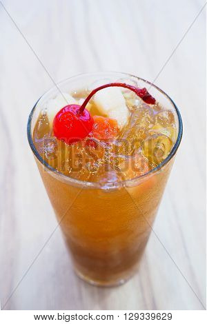 Fruit iced tea on the table. Decorate with fresh fruits.