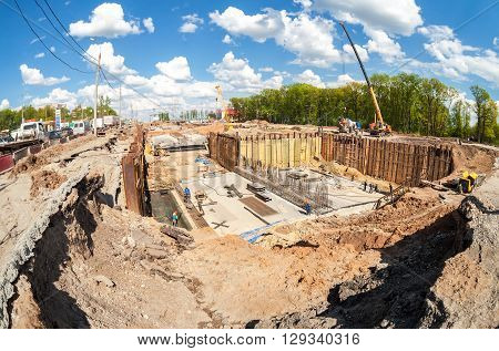 SAMARA RUSSIA - MAY 7 2016: Construction works on the construction of new motorway in summer sunny day