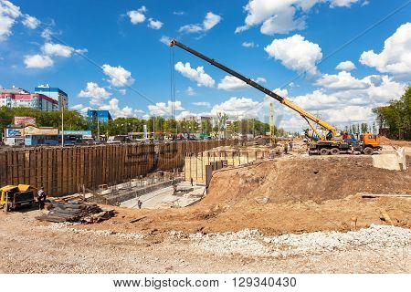 SAMARA RUSSIA - MAY 7 2016: Construction machinery at the construction of new motorway in summer sunny day