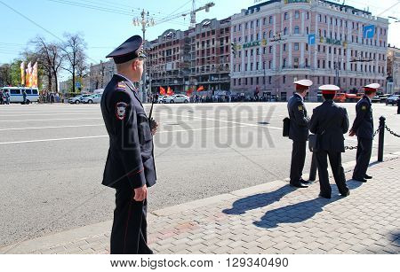 MOSCOW RUSSIAN - MAY 9 2013: Policemen in cordon wait for motorcade on TverskayaStreet on parade devoted to devoted to Victory Day. For editorial use only.