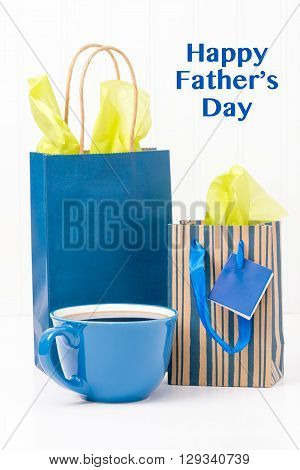A cup of coffee and gifts for dad on fathers Day. ** Note: Visible grain at 100%, best at smaller sizes