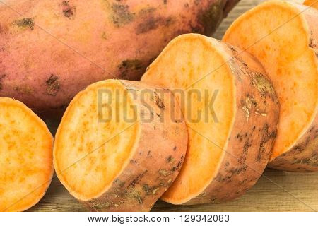 Fresh Sweet Potatoes Whole And Sliced Closeup