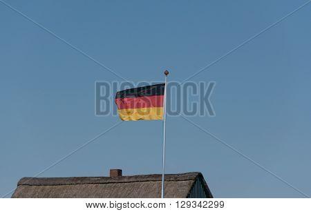 Germany flag on a flag pole on a house