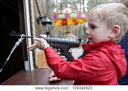 Child shooting air pistol at the rifle range