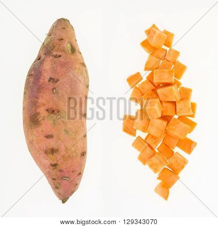 Fresh Sweet Potato Whole And Cut Into Cubes , Isolated On White Background