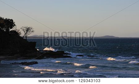 Evening scene in Port Macuarie. Splashing waves of the pacific. East coast of Australia.
