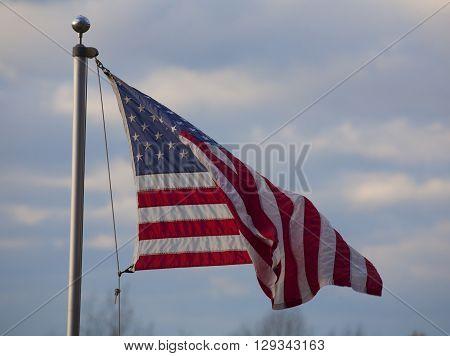 American flag flyingin a breeze on a ridge overlooking the Shenandoah