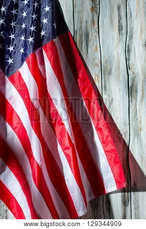 USA flag on wooden background. Banner on white wooden background. Democracy and progress. Stars and stripes.