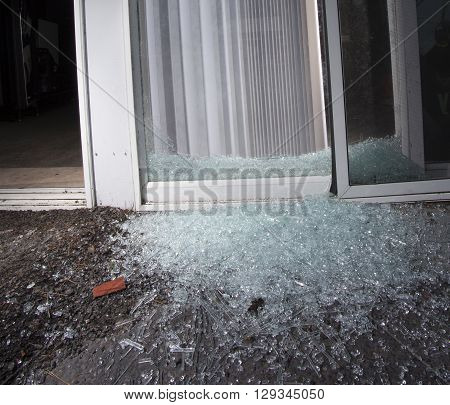 Sliding glass door in pieces after an attempted home invasion