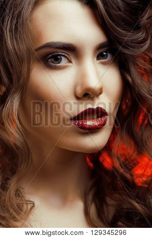 Beauty Woman with Perfect Makeup Beautiful Professional Holiday Make-up. Red Lips and Nails Beauty Girls Face isolated on Black background Glamorous Woman macro