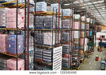 Stored goods in large distribution warehouse, elevated view