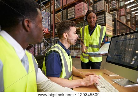 Team managing warehouse logistics in an on-site office