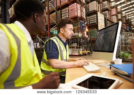 Staff working in on-site office at a distribution warehouse