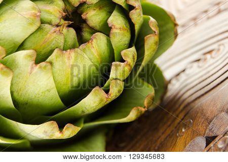 Fresh Artichoke Macro Shot On Wooden Surface