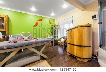MOSCOW - APRIL 2015: Interior of luxury beauty salon Philosofiya Stilya. Massage room with mini sauna in a barrel