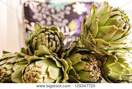 Stack Of Fresh Artichokes With Natural Light