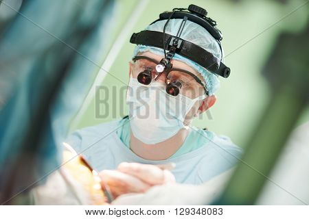male cardiac surgeon at child cardiosurgery operating room