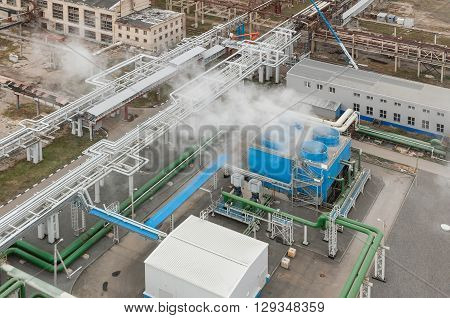 Blue industrial cooling tower at a chemical plant. Compressor station and pipeline. Top view. Fo?us on the cooling tower