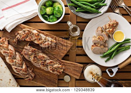 Grilled braided pork with green beans and honey mustard sauce