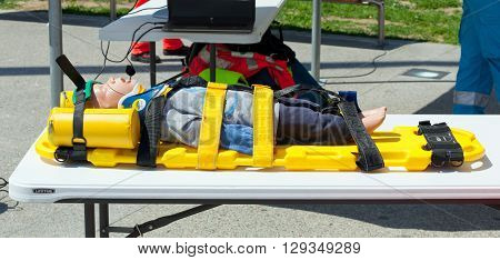 Dummy Immobilized On A Stretcher For Transport.