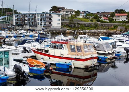 Boat parking in a quiet bay in the Norwegian fjord