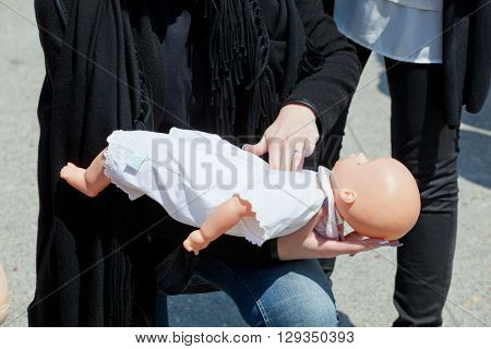 Course Of First Aid With Baby Doll