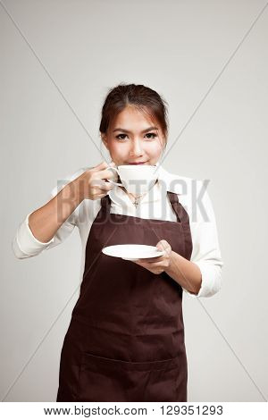 Waitress Or Barista  In Apron Drinking Coffee