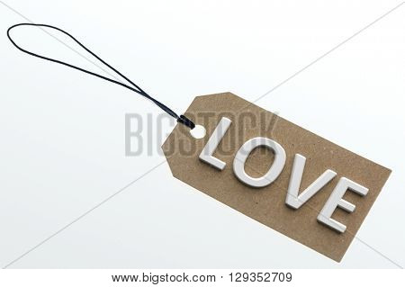 LOVE word on cardboard tag on white background.Isolated
