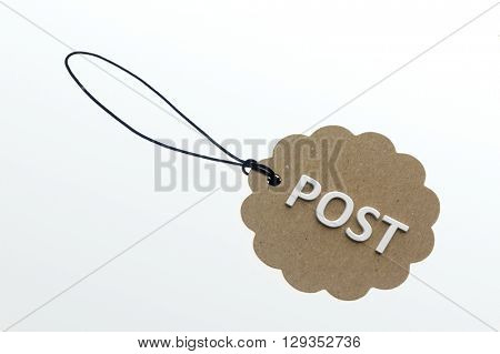 POST word on cardboard tag on white background.Isolated