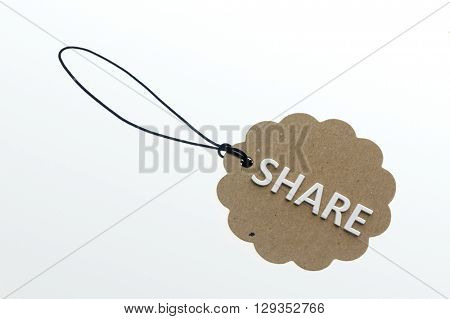 SHARE word on cardboard tag on white background.Isolated