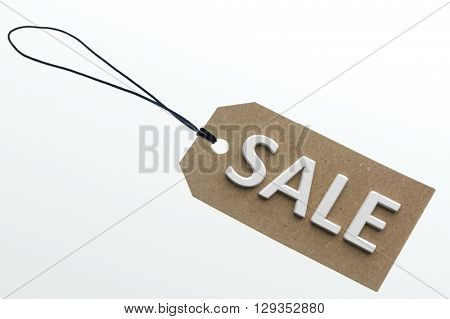 SALE word on cardboard tag on white background.Isolated