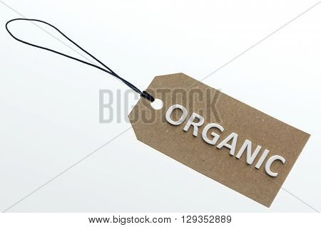 ORGANIC word on cardboard tag on white background.Isolated