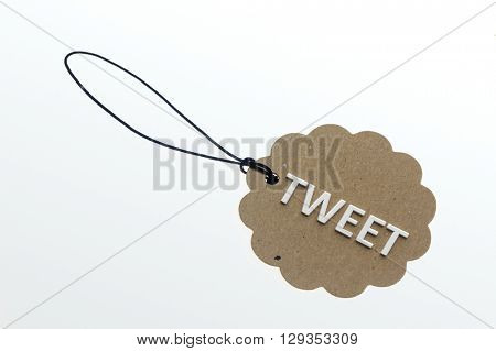TWEET word on cardboard tag on white background.Isolated