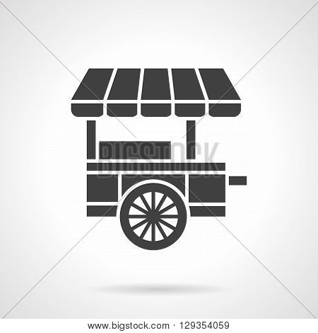 Trade cart with striped awning. Mobile market for sale of ice cream, drinks or other desserts. Food trolley theme. Symbolic black glyph style vector icon. Element for web design and mobile.