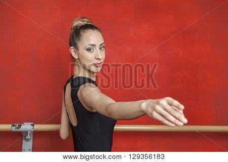 Portrait Of Ballerina Dancing In Rehearsal Room