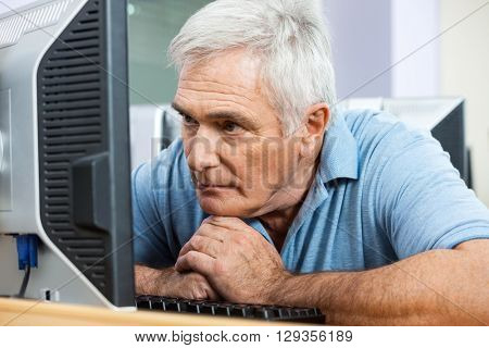 Worried Senior Man Looking At Computer In Class