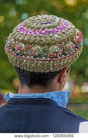Hats traditional Bulgarian male embroidered with popular models and placed on a man's head.
