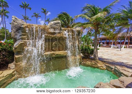 Beautiful wall and waterfall pouring out of it. Aruba hotel