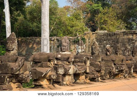 Sculptures of demons in the temple complex of Angkor Thom Cambodia