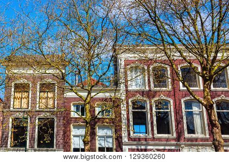 gables of typical buildings along a canal in Gouda Netherlands