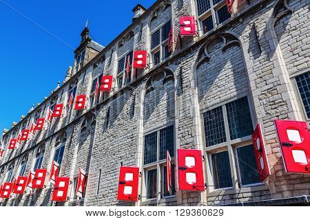 facade detail of the historical city hall on the market square in Gouda Netherlands