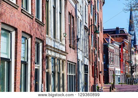 typical row houses along a canal in Gouda Netherlands
