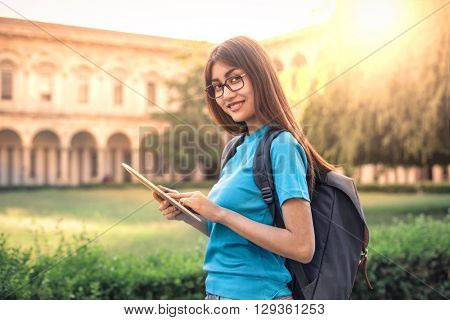 Happy student with tablet