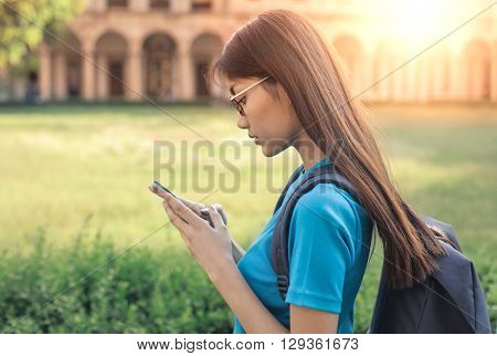 Girl using her smart phone