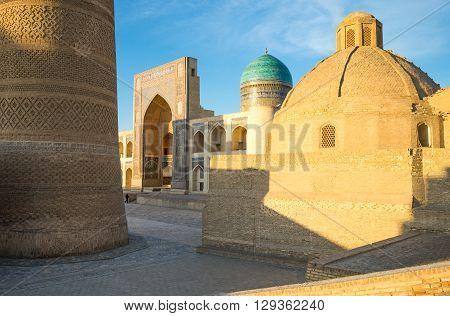 Buckara Uzbekistan - Aprilr 16 2014: The Kalon minaret and the Mir-i-Arab madrassah in the background