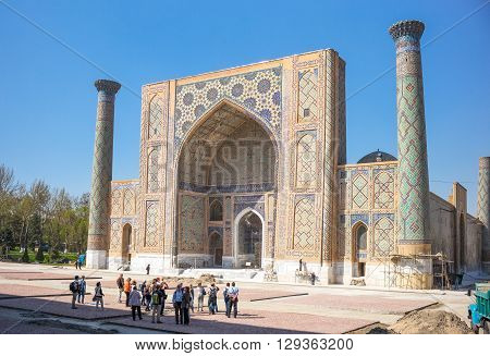 Samarkand Uzbekistan - April 18 2014: People in Registan square with the Ulugbek madrassah