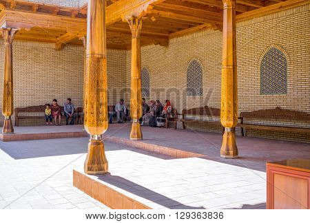 Samarkand Uzbekistan - April 18 2014: Local faithful in the St Daniel mausoleum